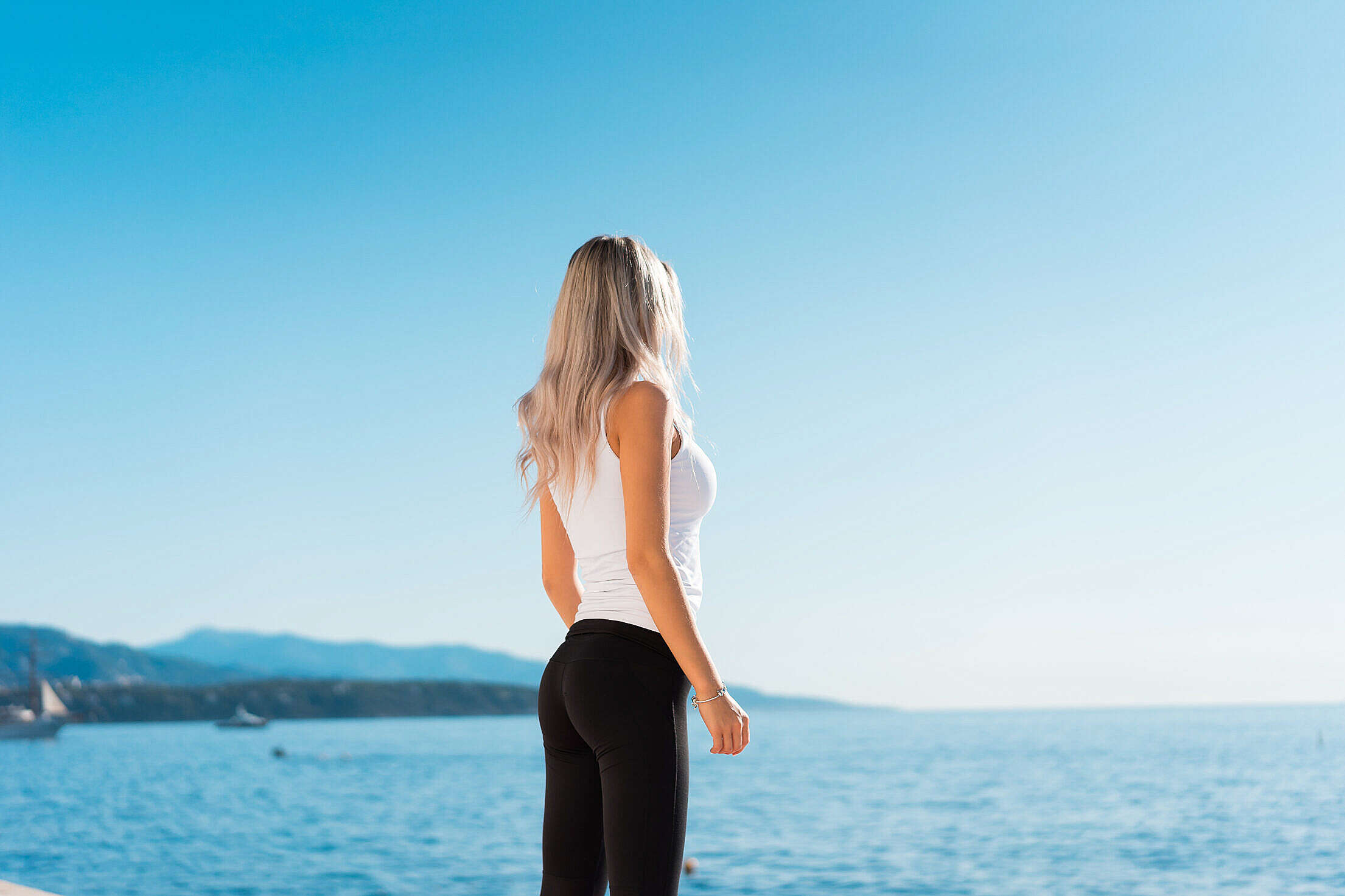 Young Fitness Woman Overlooking the Sea in the Morning Free Stock Photo