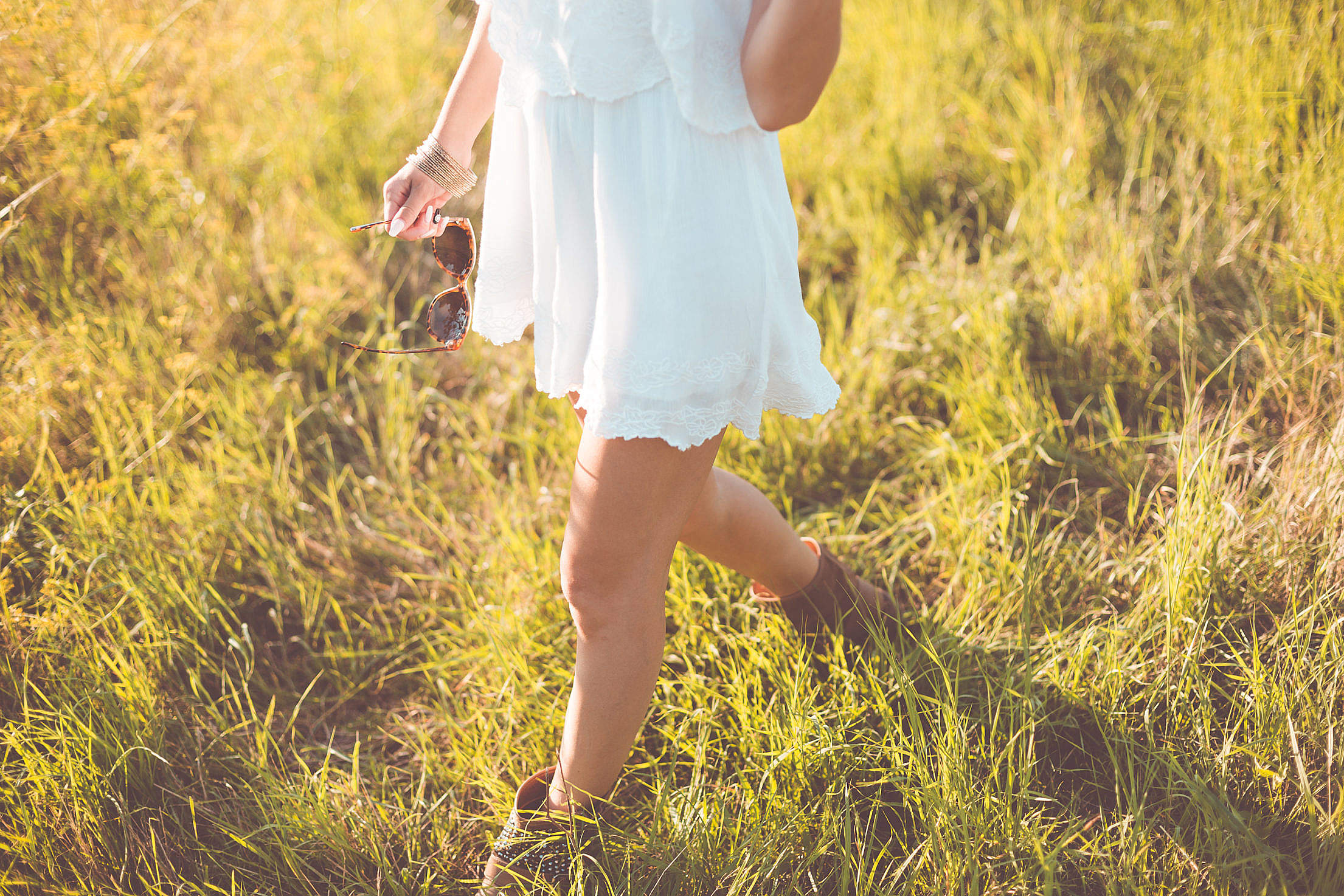 Young Girl Enjoying Her Free Time In a Sunny Meadow Free Stock Photo
