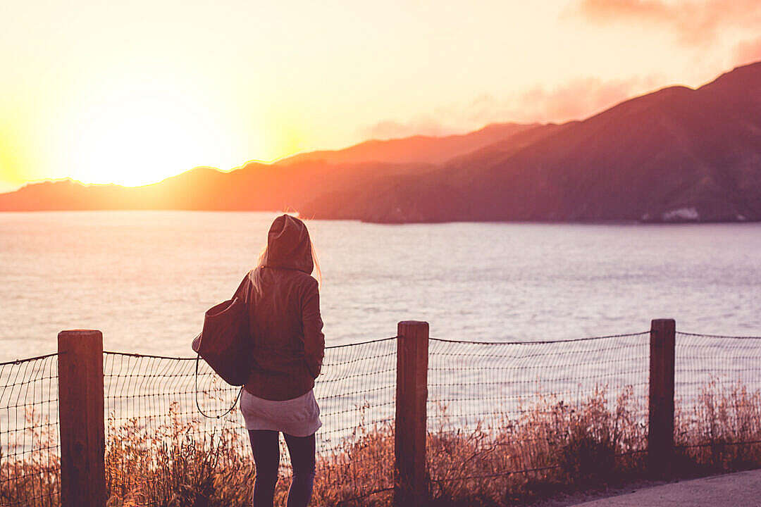 Download Young Girl on a Walk Near The Shore at Sunset #2 FREE Stock Photo