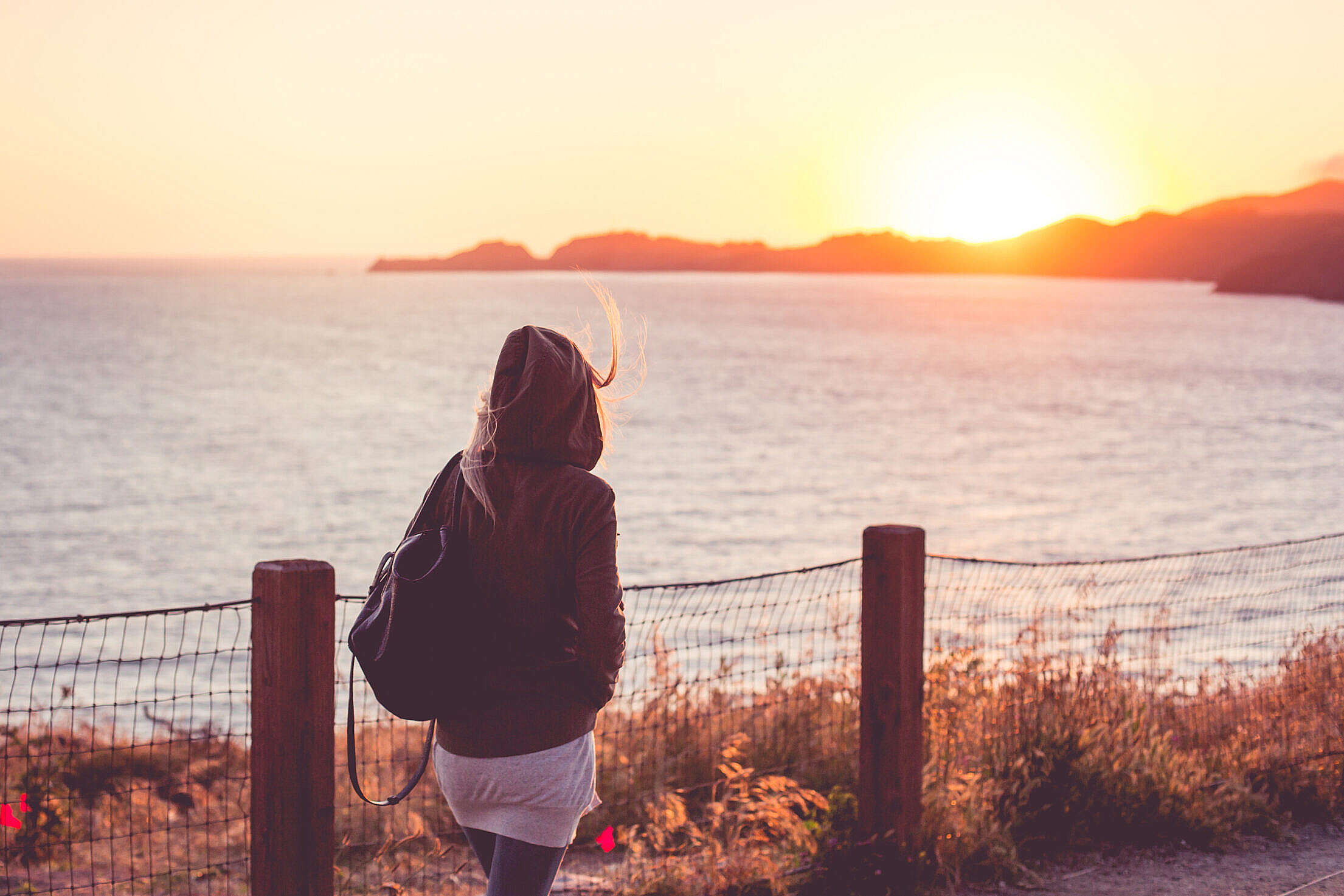 Young Girl on a Walk Near The Shore at Sunset Free Stock Photo
