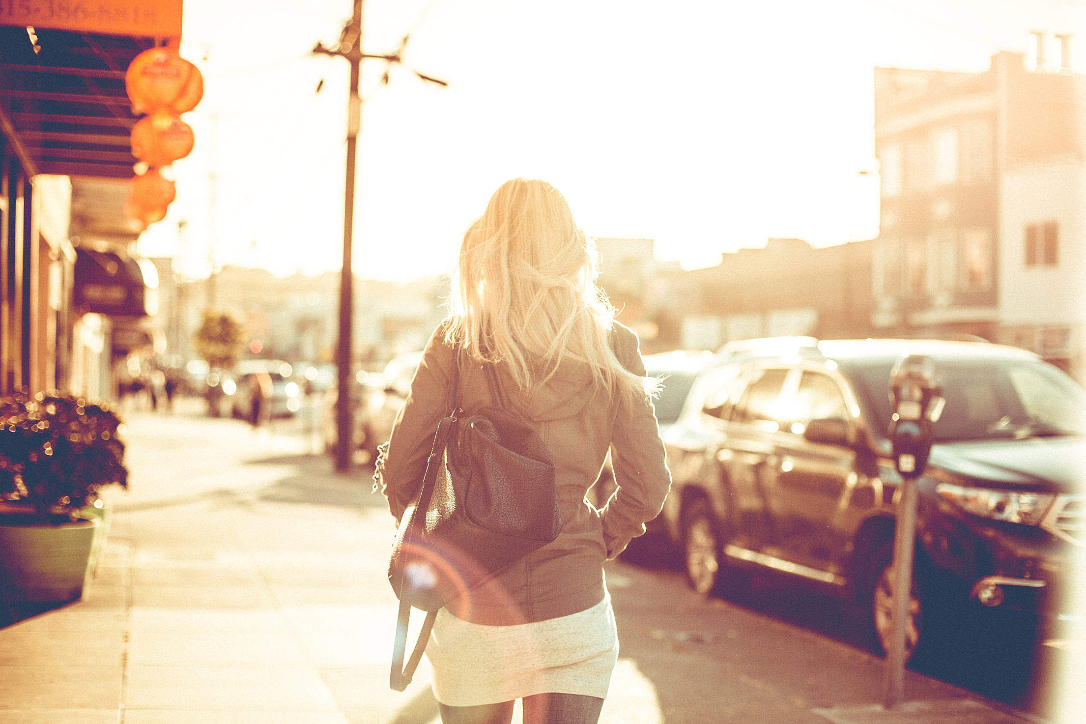 Young Girl Walking Down the Street Free Stock Photo