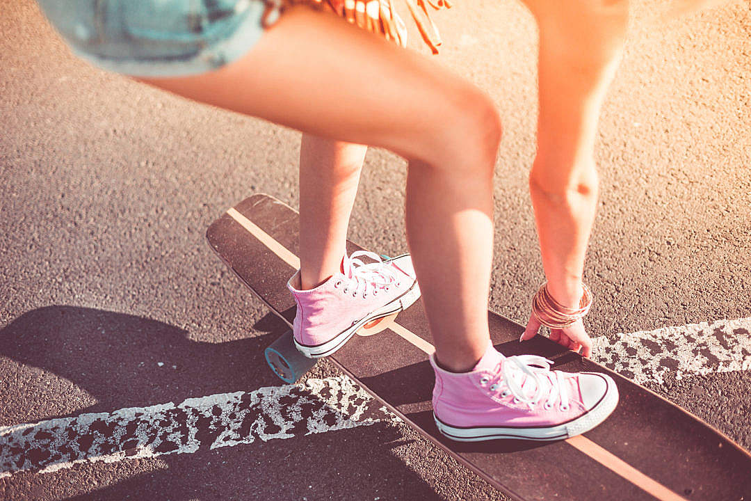Download Young Girl with Pink Shoes on Longboard FREE Stock Photo