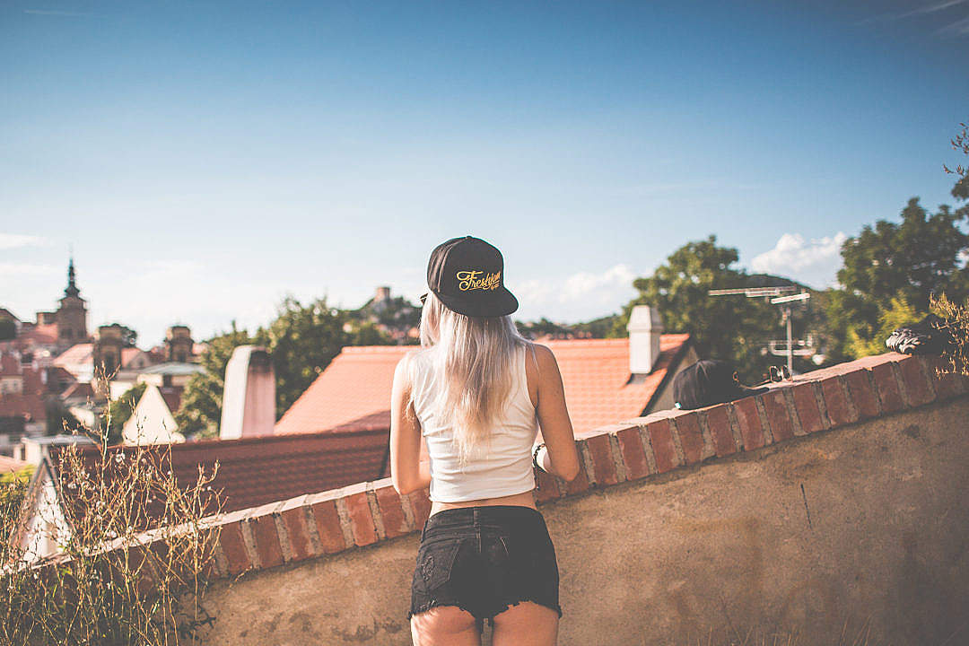 Download Young Girl with Snapback Looking over the Old City FREE Stock Photo