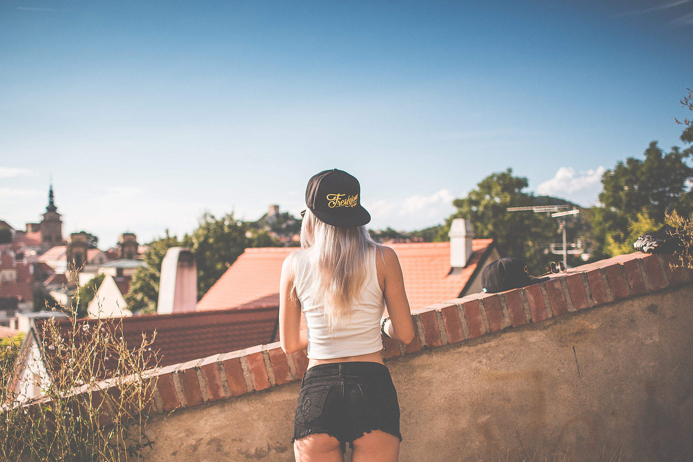 Young Girl with Snapback Looking over the Old City Free Stock Photo