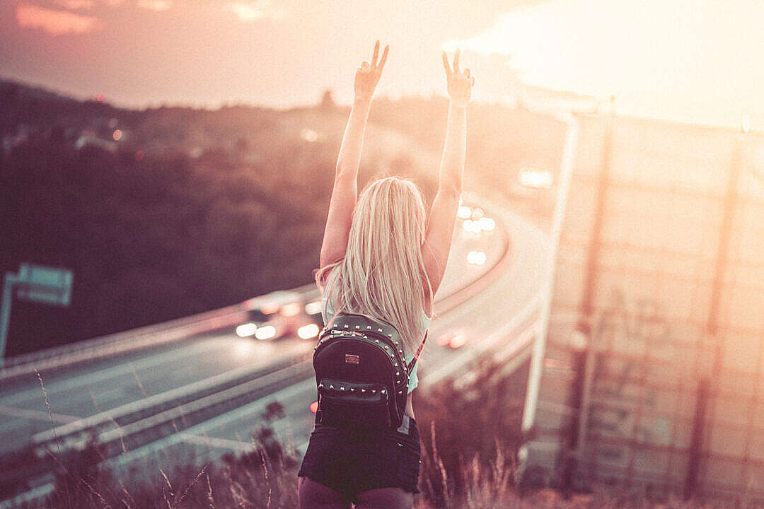 Download Young Happy Woman Enjoying Freedom on a Walk FREE Stock Photo