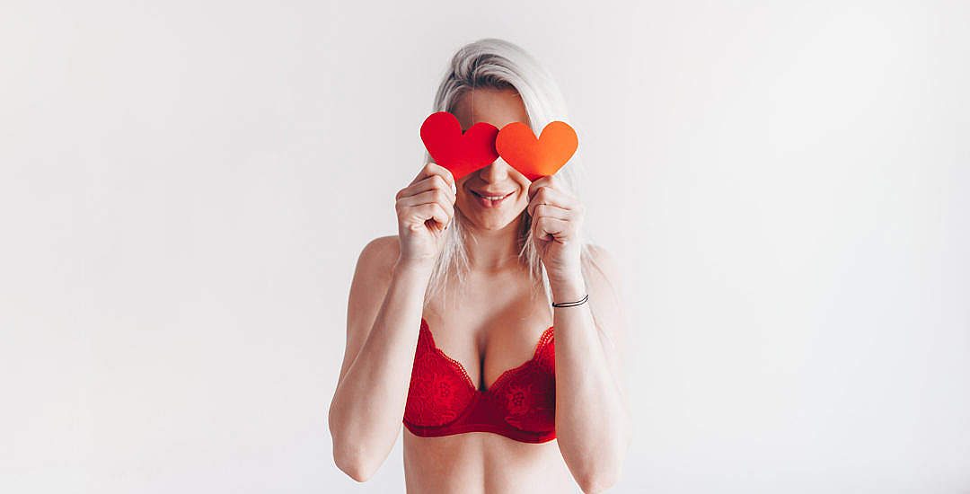 Download Young Happy Woman with Valentine's Day Hearts FREE Stock Photo