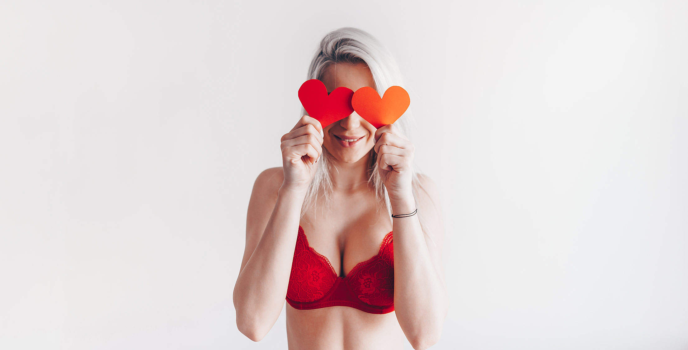 Young Happy Woman with Valentine's Day Hearts Free Stock Photo