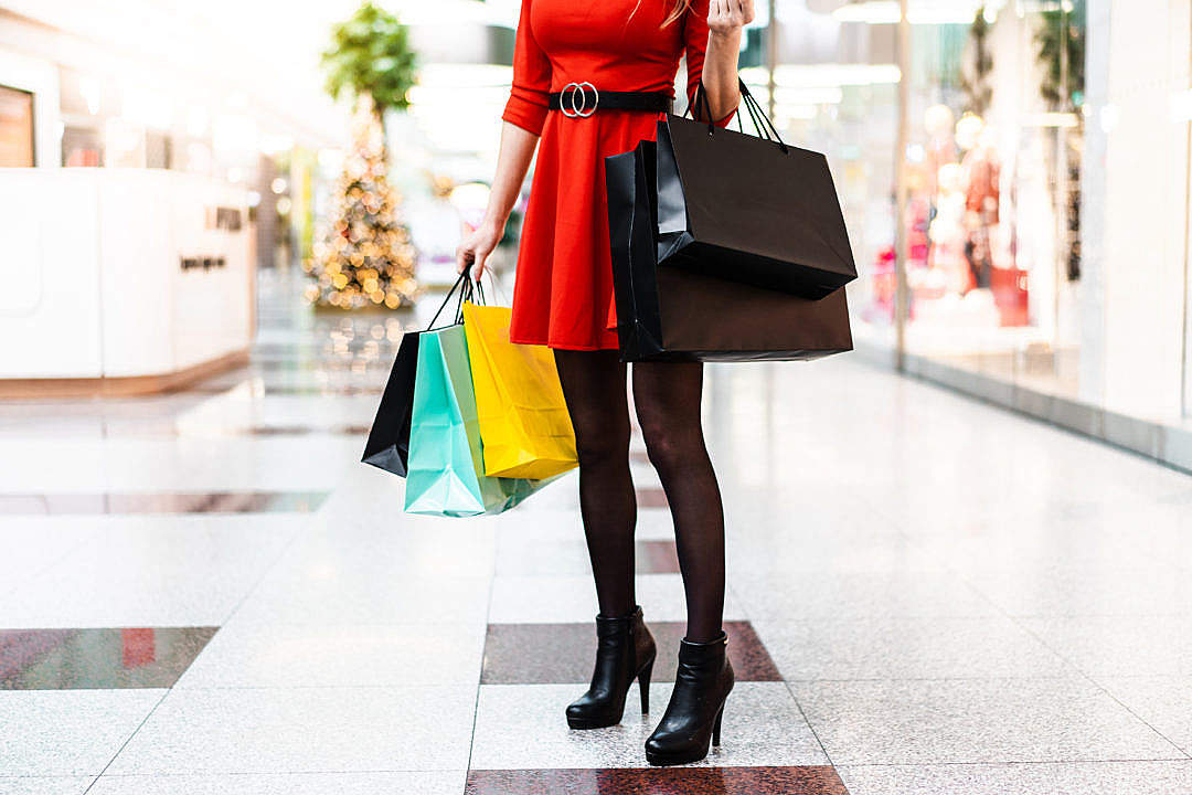 Download Young Lady After Christmas Shopping FREE Stock Photo