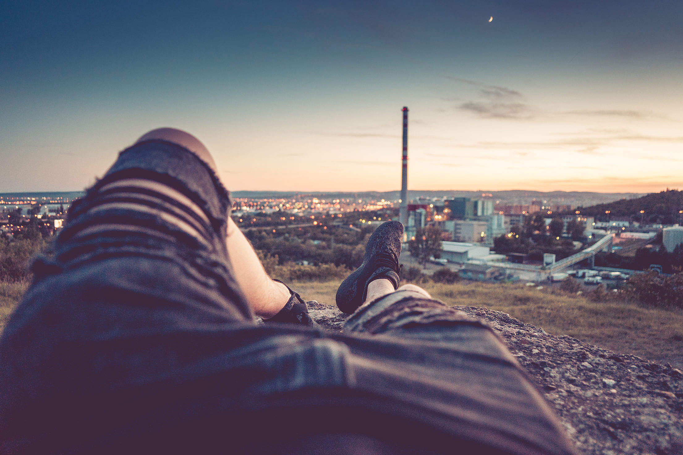 Young Man Chilling and Enjoying Evening Cityscape View Free Stock Photo