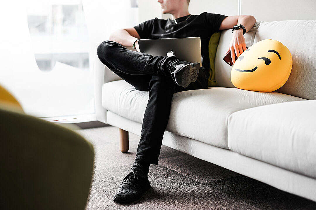 Download Young Man Thinking and Working with Laptop in Office Space FREE Stock Photo