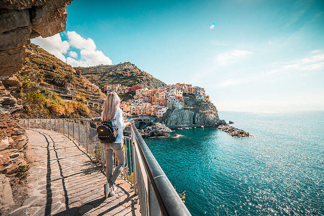 Download Young Traveler Admires Beautiful Manarola Town, Italy FREE Stock Photo