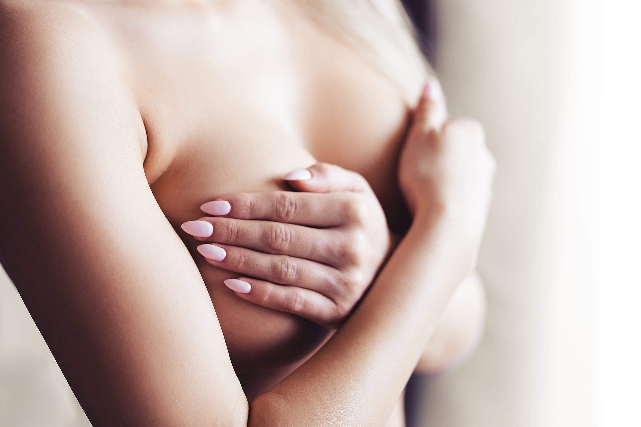 Young Woman Covering Her Breasts Free Stock Photo