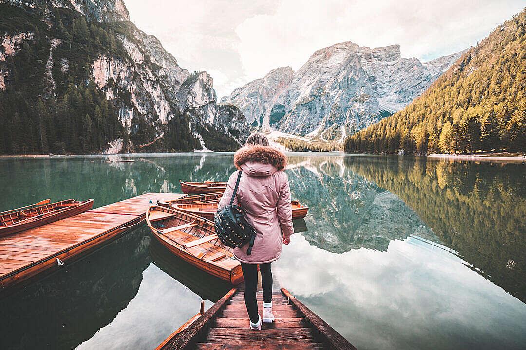 Download Young Woman Enjoying Beautiful Scenery of Lago di Braies, Italy FREE Stock Photo