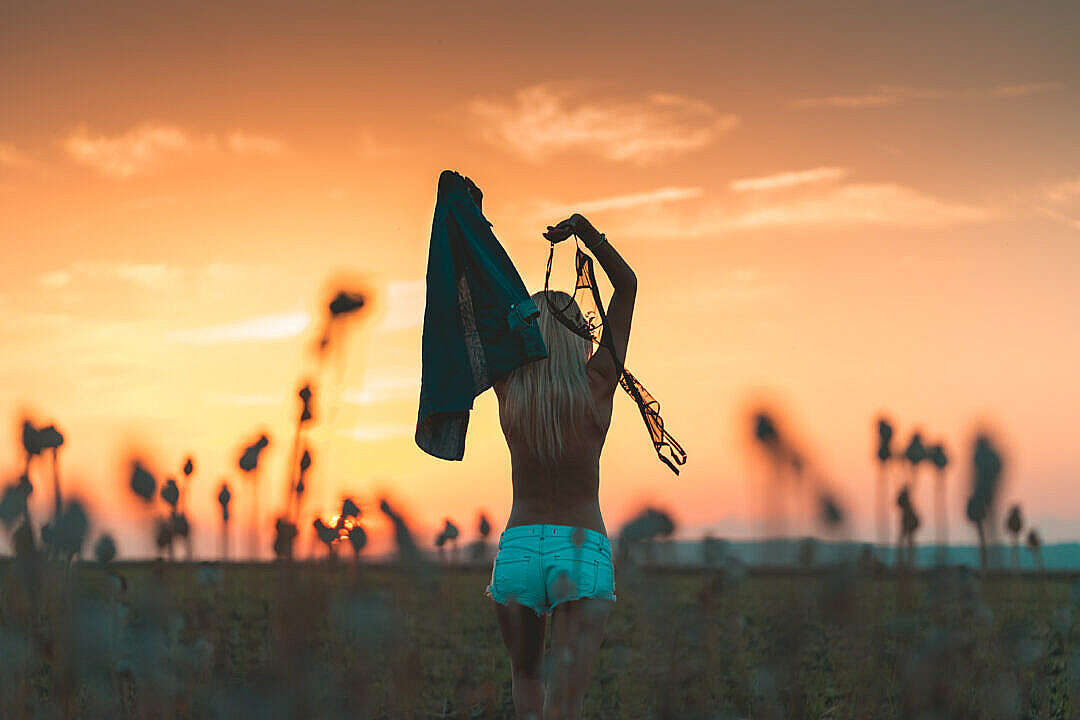 Download Young Woman Enjoying Freedom and Throwing Her Bra Away FREE Stock Photo