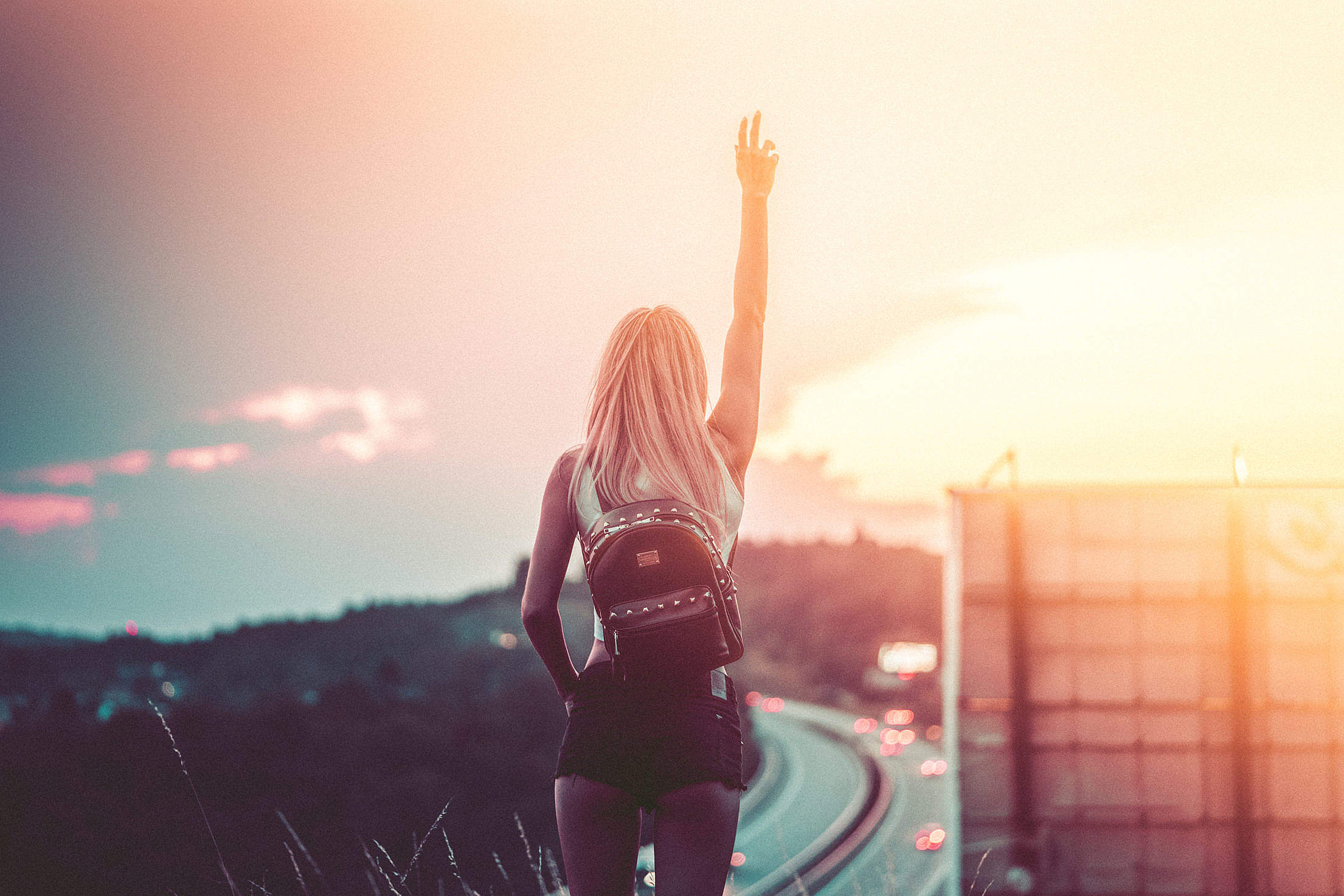 Young Woman Enjoying Freedom in the Summer Evening Free Stock Photo