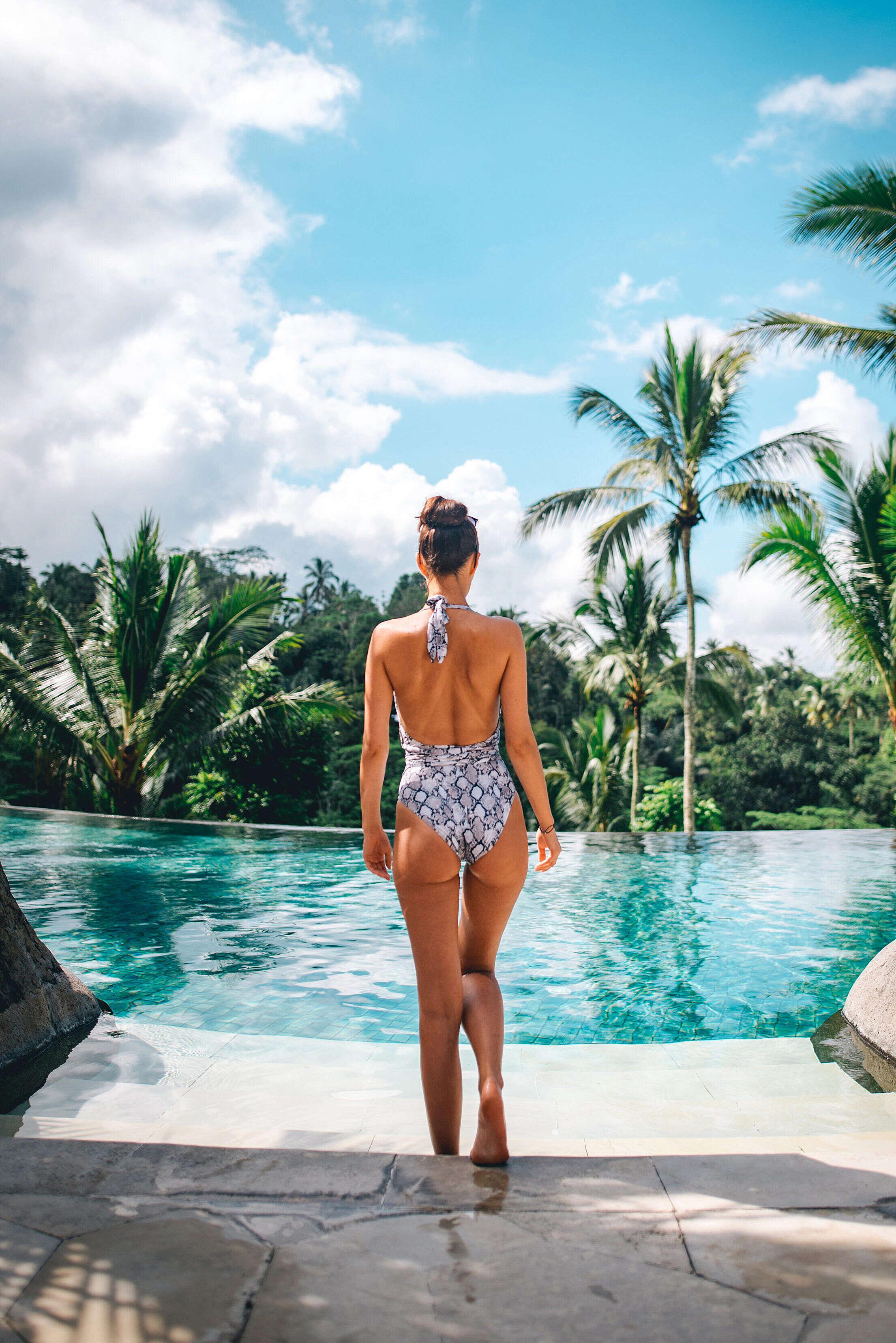 Young Woman Enjoying Luxury & Exotic Swimming Pool Free Stock Photo