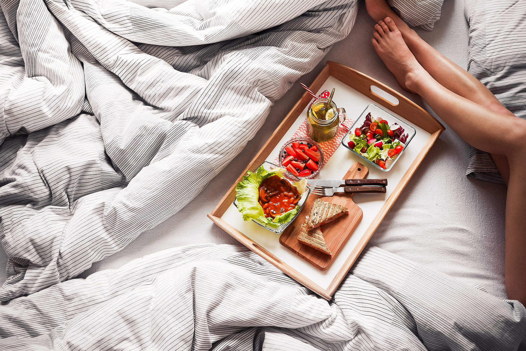 Young Woman Enjoying Morning Breakfast in Bed Free Stock Photo