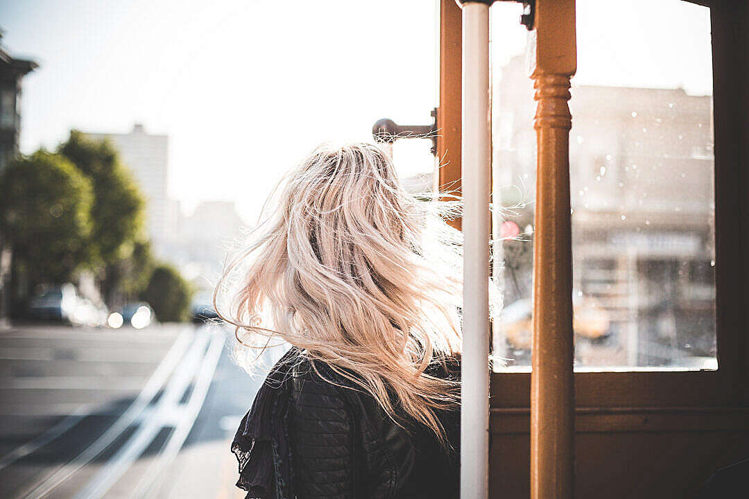 Download Young Woman Enjoying Ride on an Iconic Cable Car in San Francisco #2 FREE Stock Photo