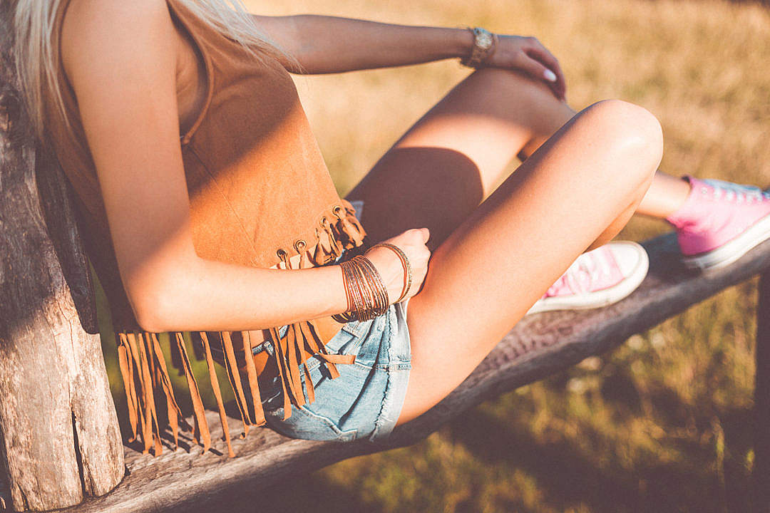 Download Young Woman Enjoying Sunset in Boho Style FREE Stock Photo