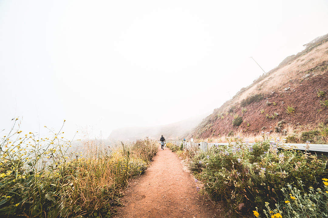Download Young Woman Hiking the Mountain Trail in Foggy Weather FREE Stock Photo
