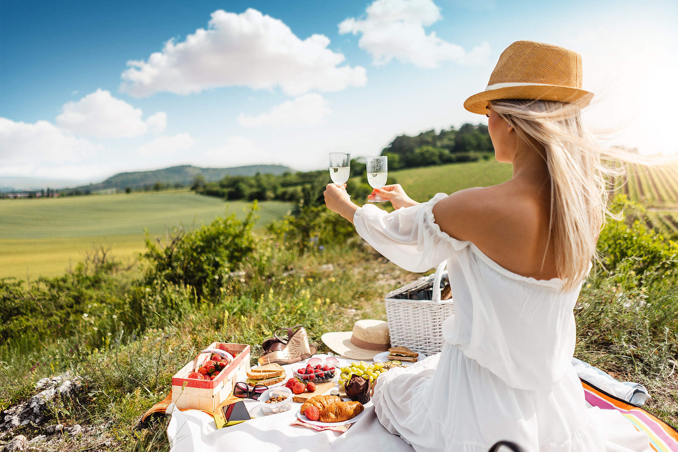 Young Woman Holding Glasses of Prosecco Free Stock Photo