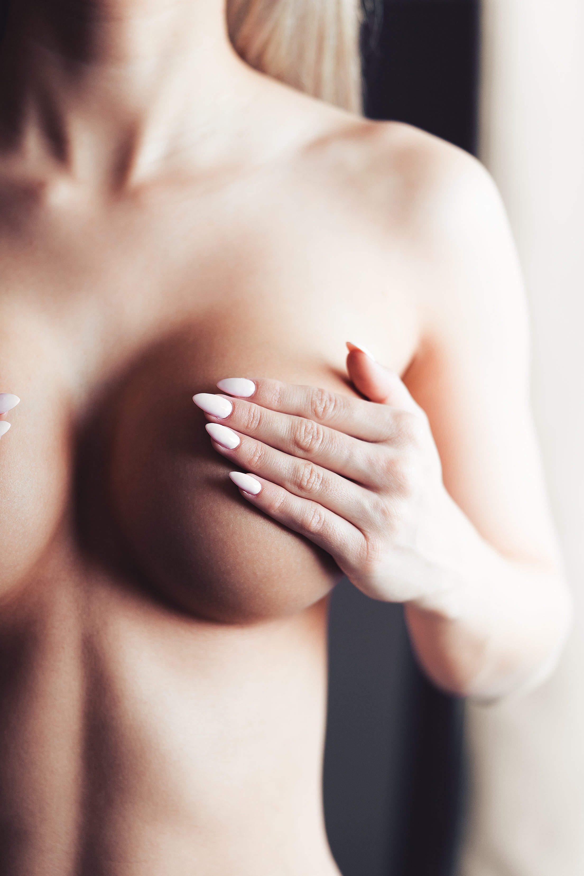 Young Woman Holding Her Breasts Free Stock Photo