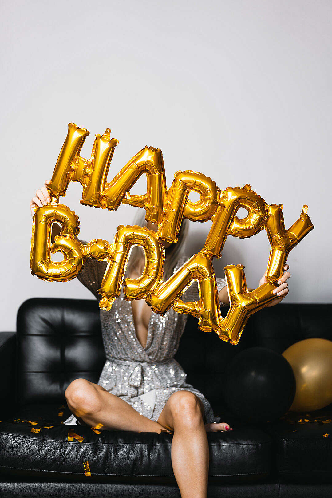 Download Young Woman Holding Inflatable Happy BDay Birthday Balloons FREE Stock Photo