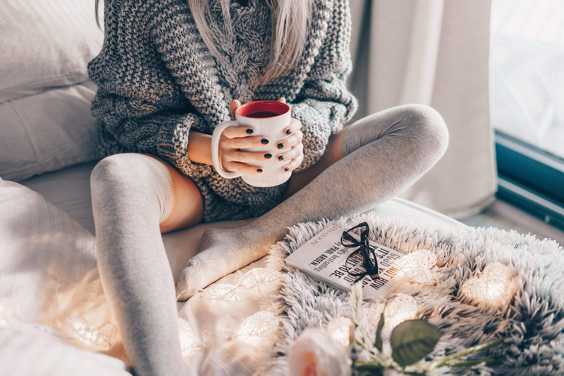 Young Woman in Bed with Hot Tea Free Stock Photo