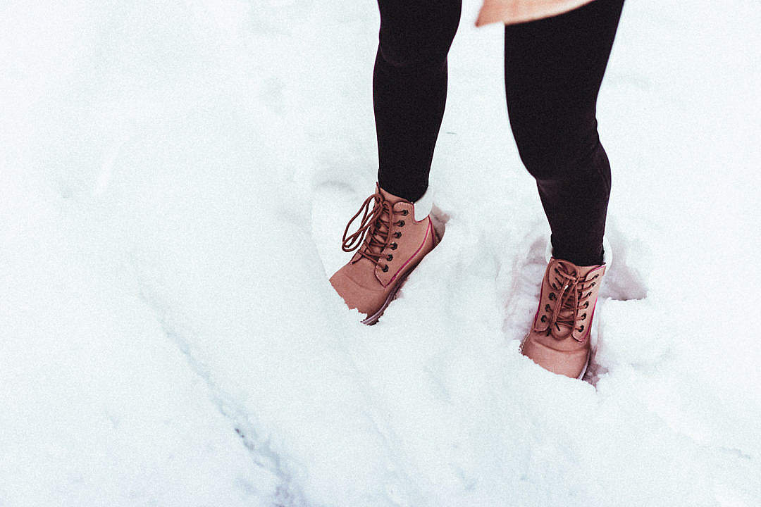 Download Young Woman in Winter Shoes in Snow FREE Stock Photo