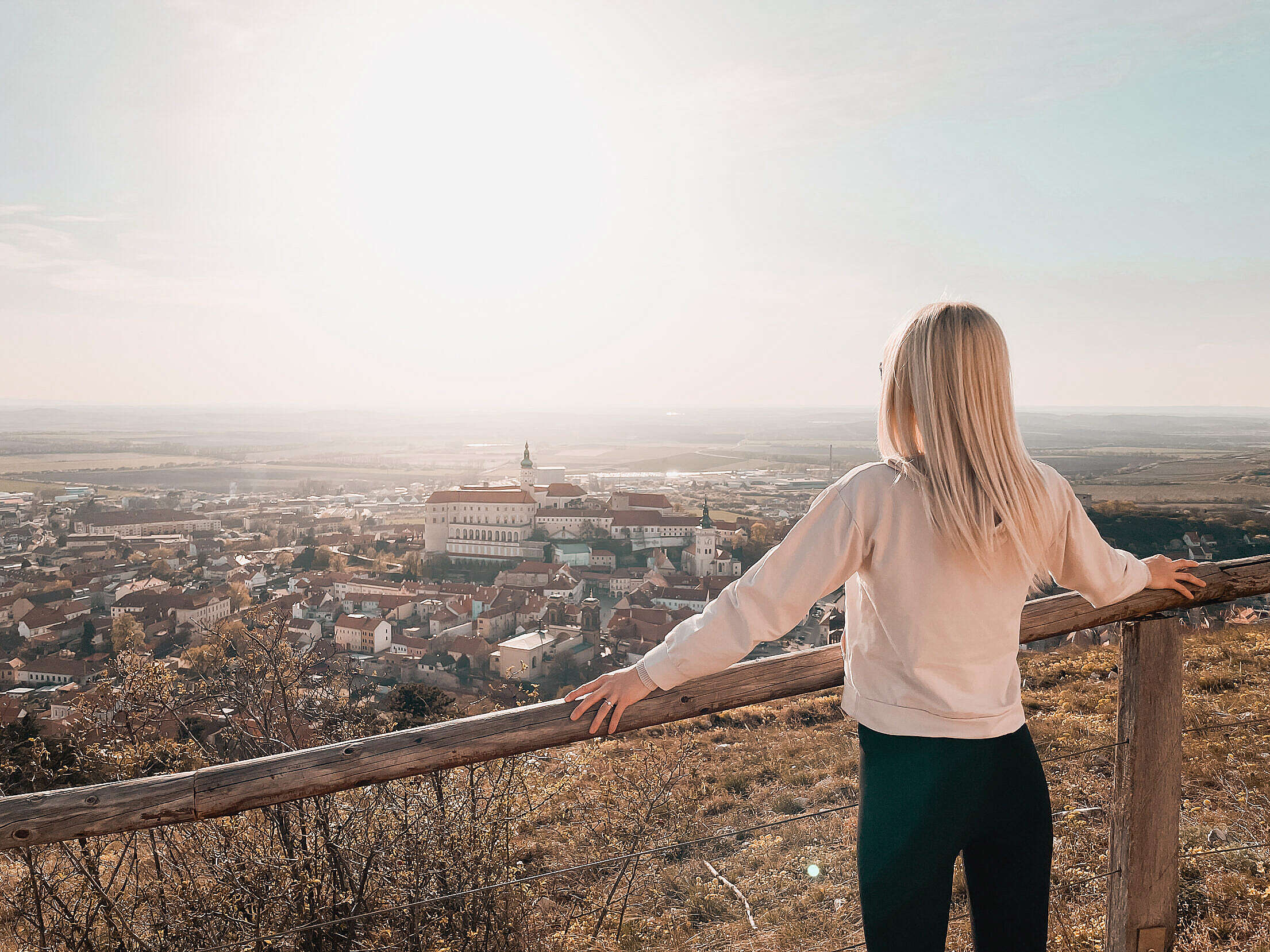 Young Woman Looking at Mikulov City Free Stock Photo