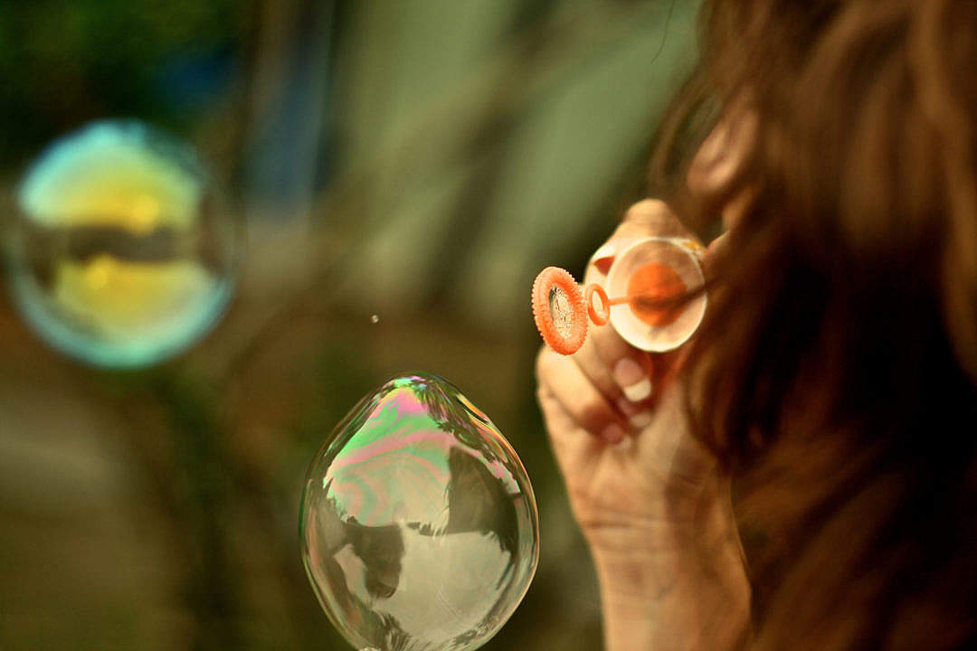 Download Young Woman Making Bubbles FREE Stock Photo
