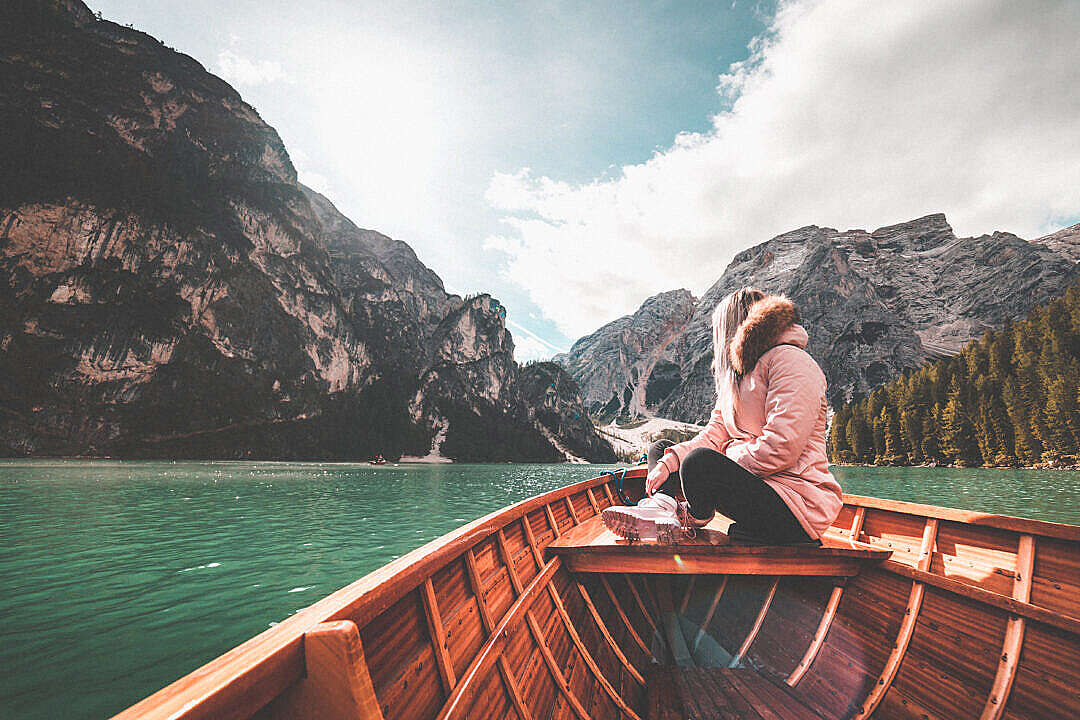 Download Young Woman Relaxing on a Rowing Boat & Enjoying the Nature FREE Stock Photo