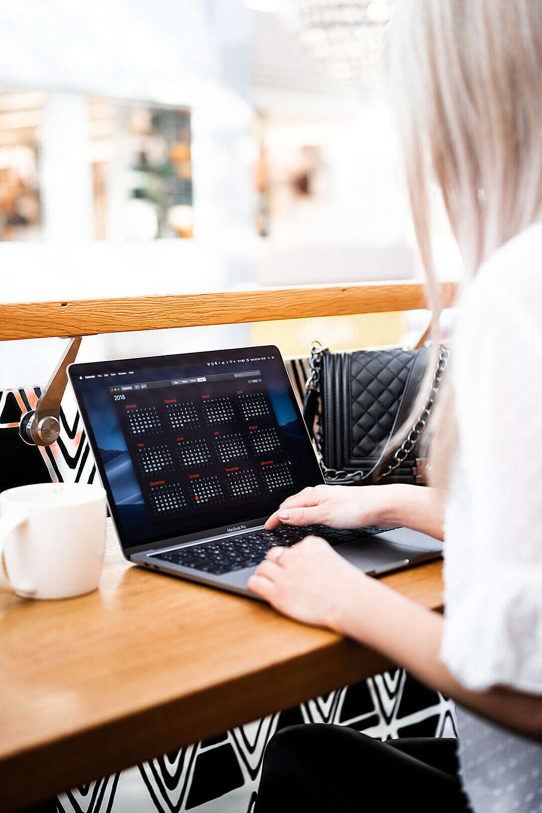 Download Young Woman Remote Working in a Café FREE Stock Photo