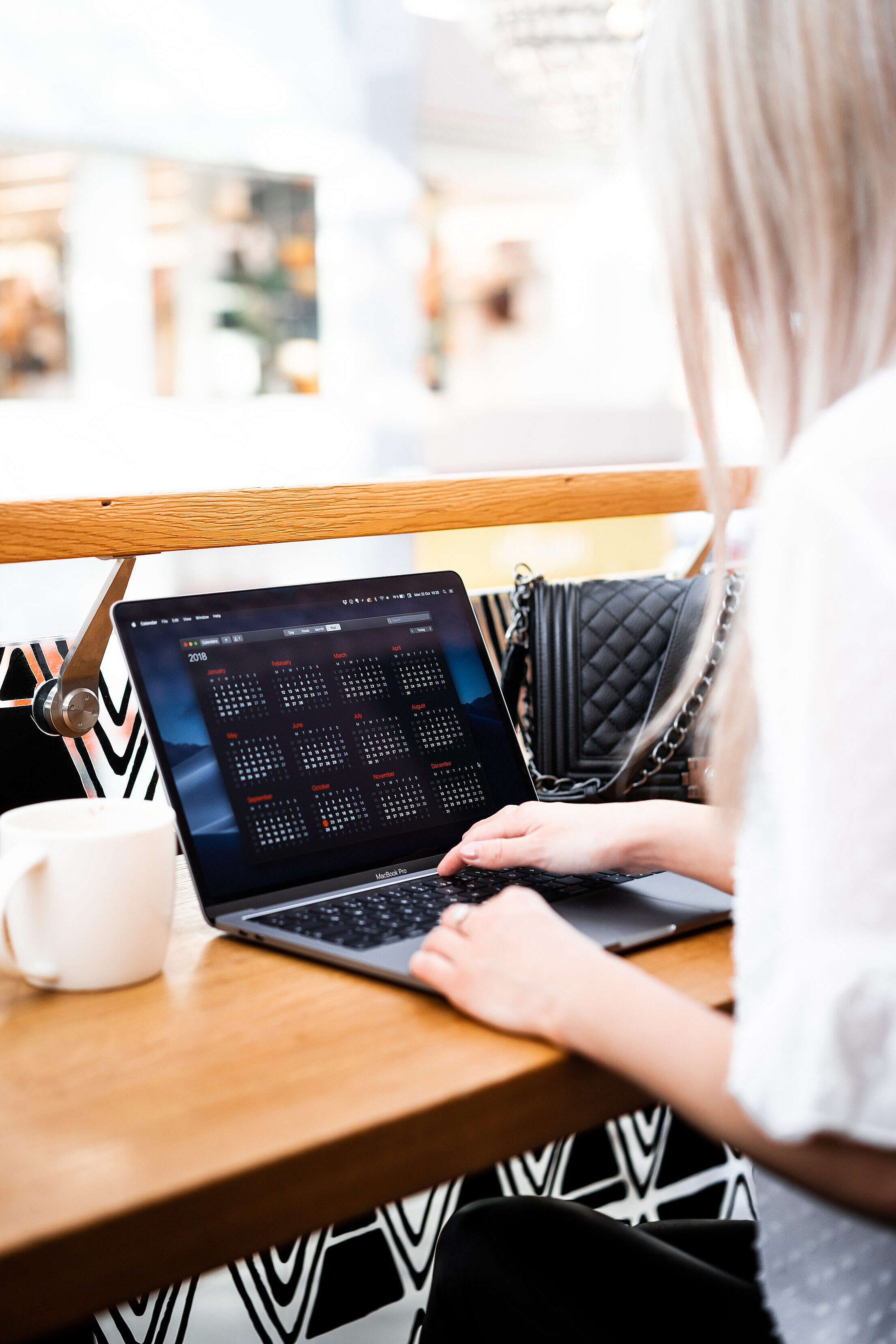 Young Woman Remote Working in a Café Free Stock Photo