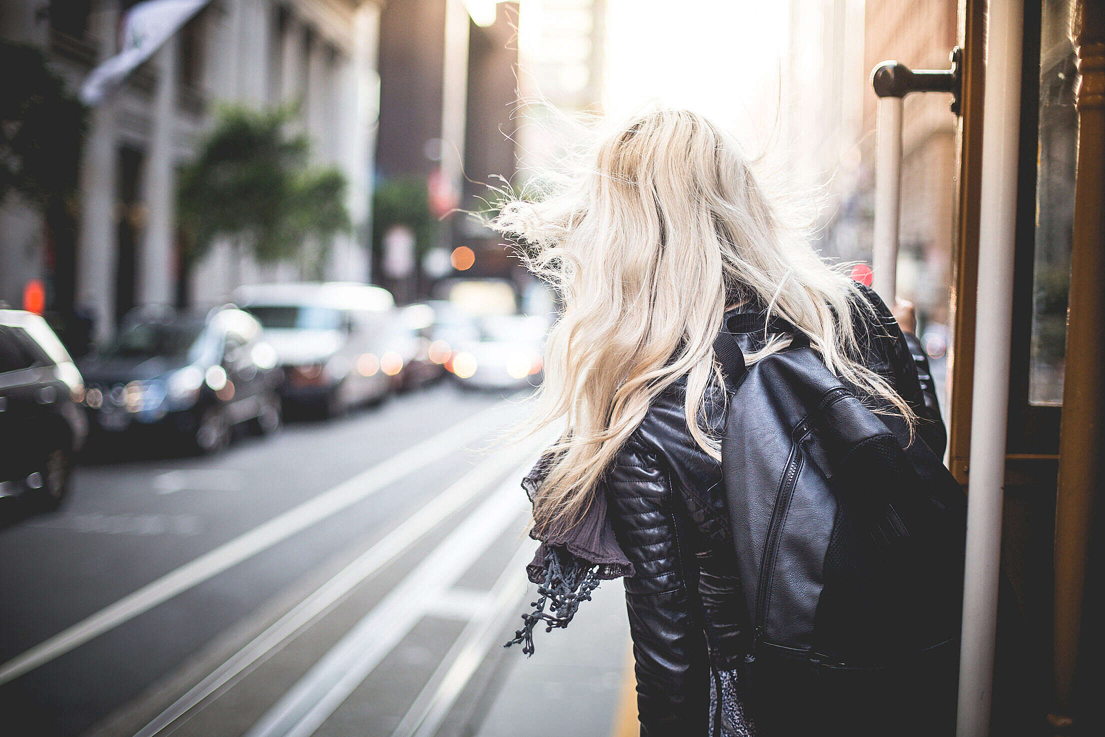 Young Woman Riding The Famous Cable Car in San Francisco Free Stock Photo
