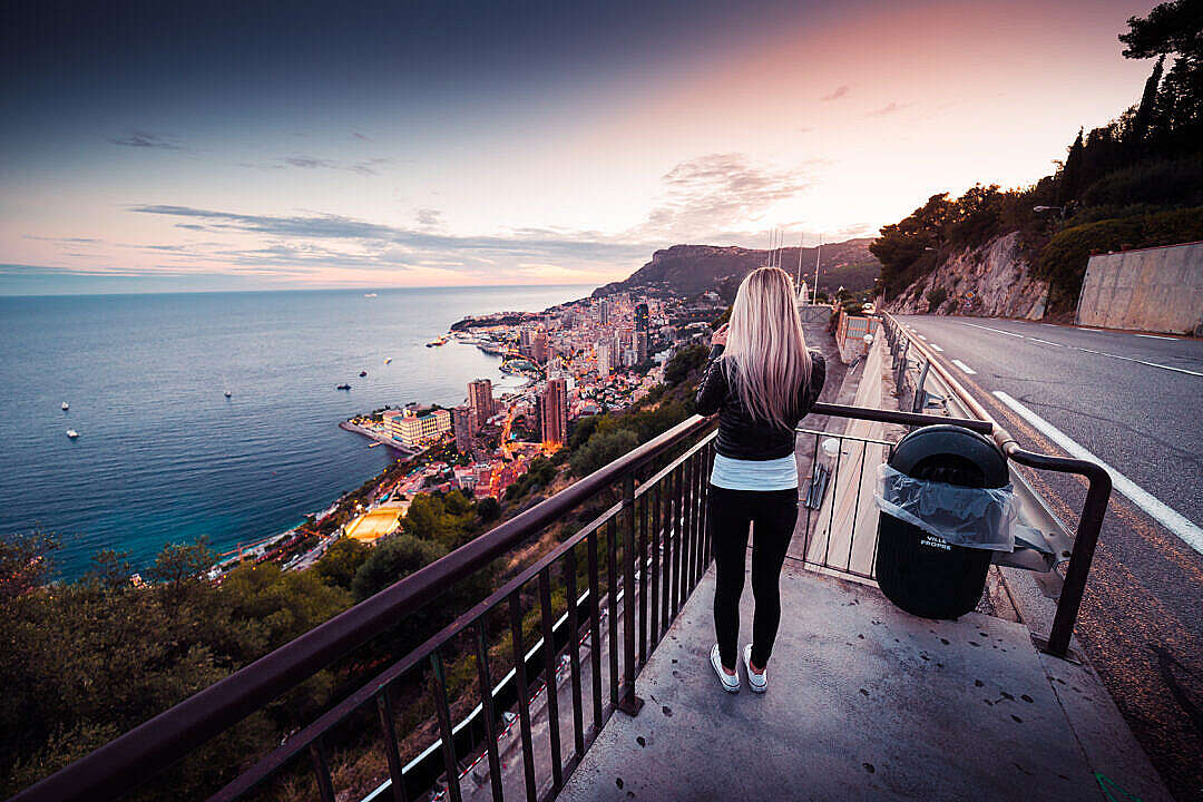 Download Young Woman Taking a Picture of Evening Monaco FREE Stock Photo