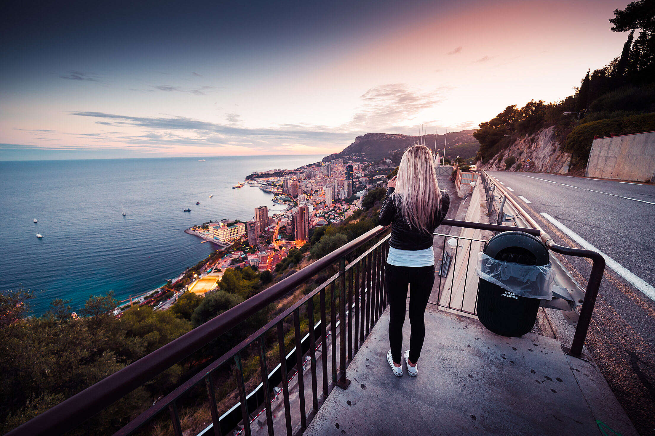 Young Woman Taking a Picture of Evening Monaco Free Stock Photo