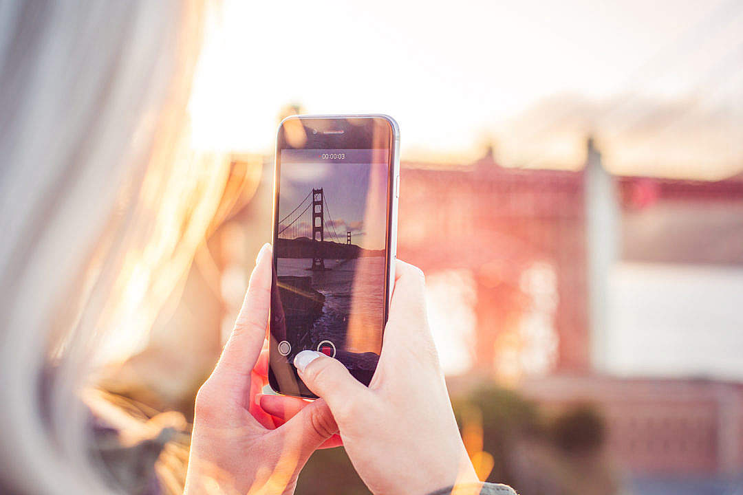 Download Young Woman Taking a Video of The Golden Gate Bridge FREE Stock Photo