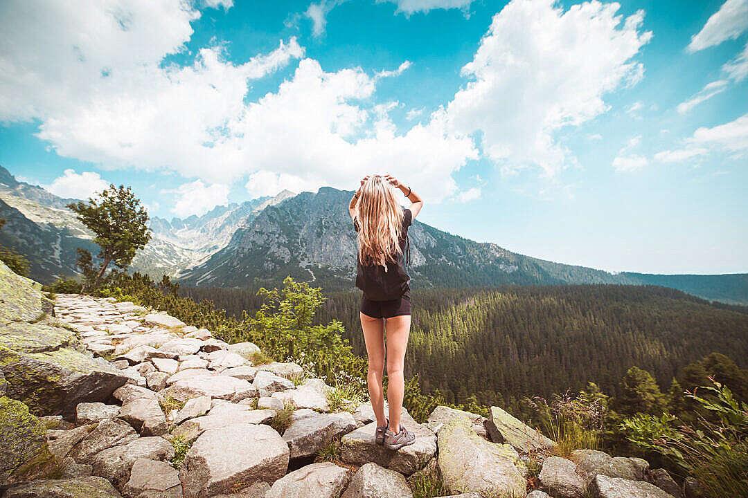 Download Young Woman Traveler Enjoying a View on High Tatras Mountains FREE Stock Photo