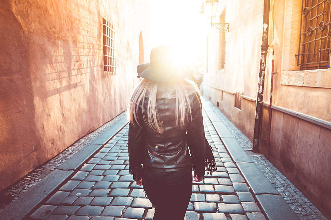Download Young Woman Walking Alone in Prague Streets FREE Stock Photo