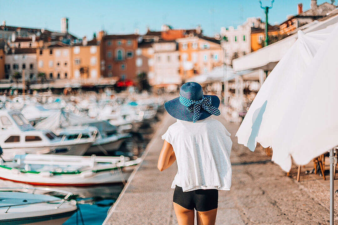 Download Young Woman Walking Around The Harbor in Croatia FREE Stock Photo