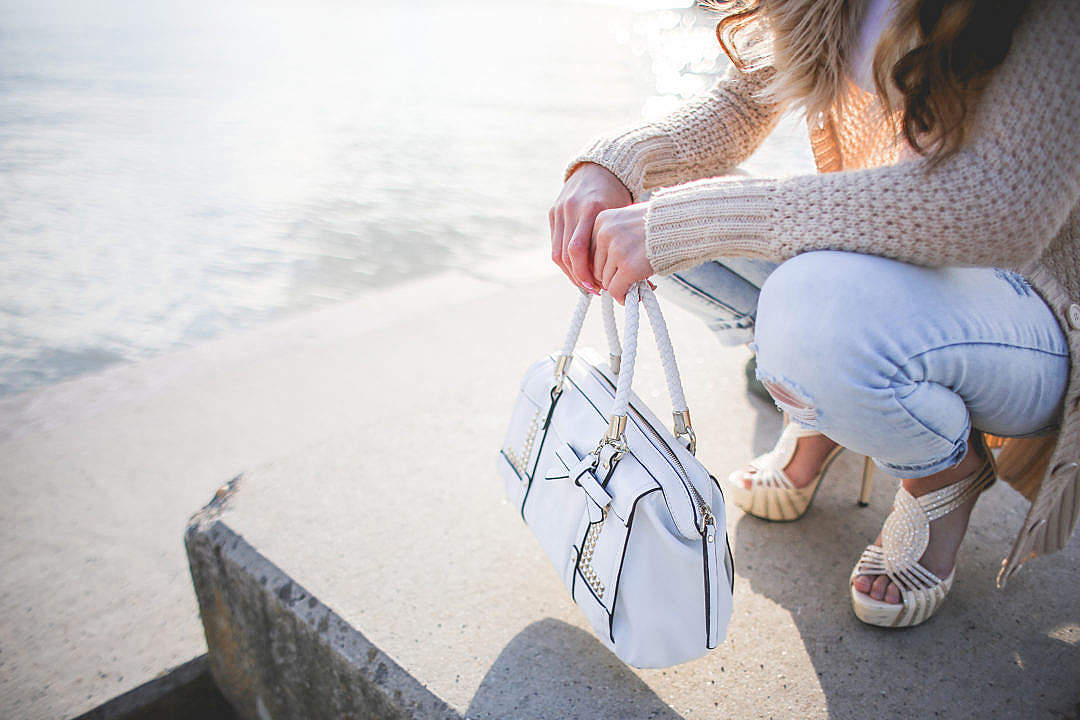 Download Young Woman with a White Handbag FREE Stock Photo