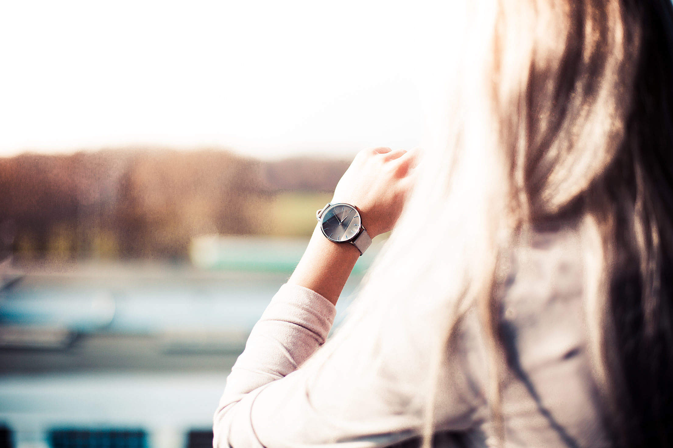 Download Young Woman with Gray Fashion Watches Enjoying Views Free Stock Photo