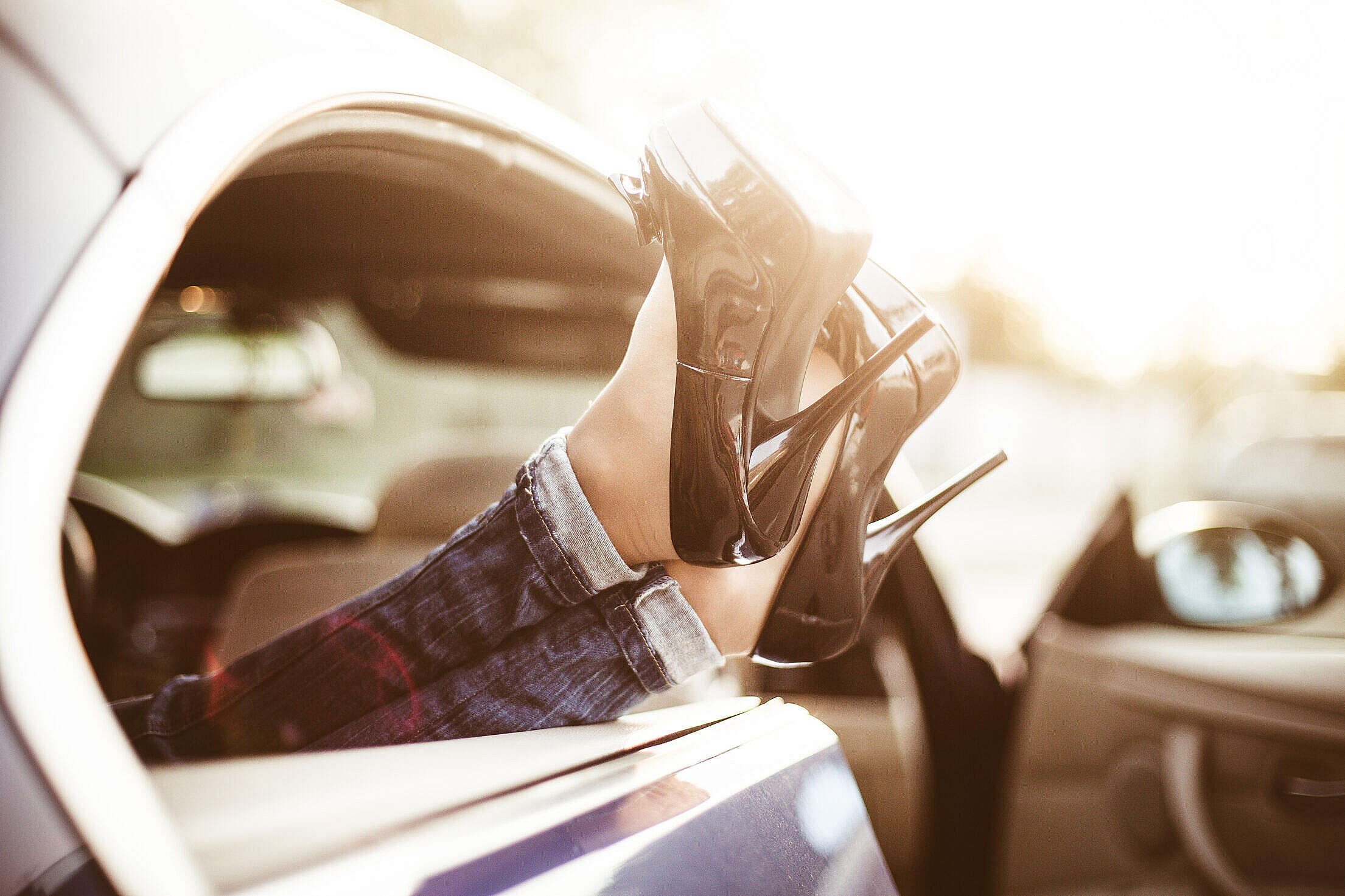 Young Woman With High Heels in Car Transport Limousine Service Free Stock Photo