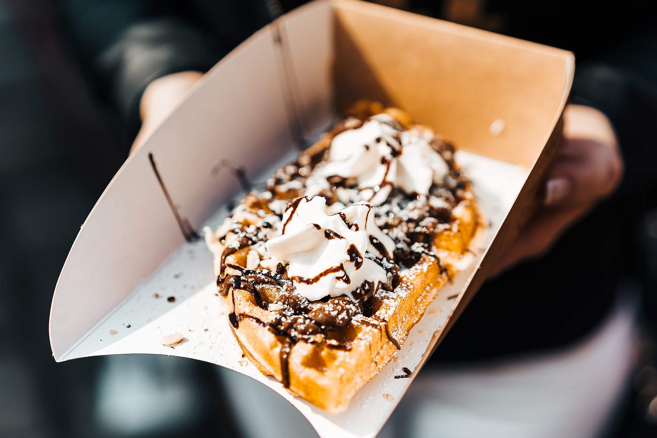 Download Yummy Chocolate Waffles from Open Air Food Market Free Stock Photo