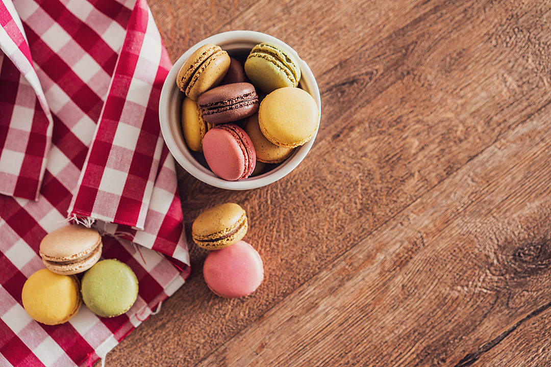 Download Yummy Colorful Macarons on Wooden Table FREE Stock Photo